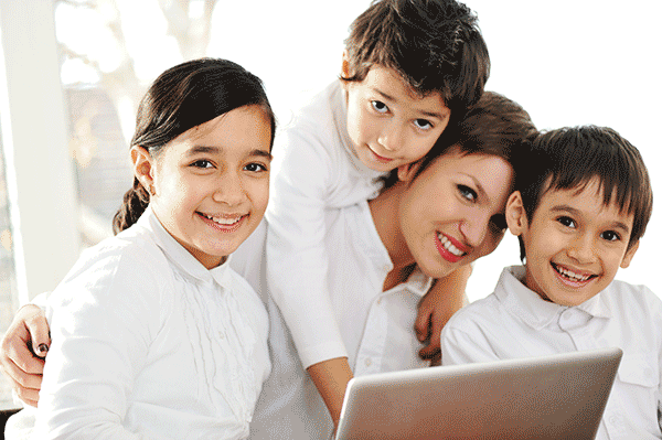 mother-with-children-using-laptop-at-home